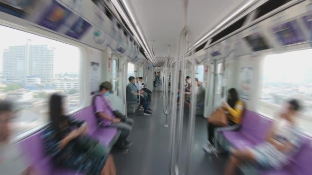 passagerare på skytrain, hyperlapse - inuti bildbanksvideor och videomaterial från bakom kulisserna