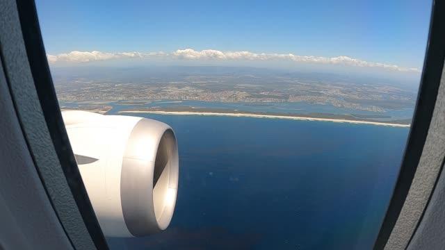 passengers onboard a qantas flight number qf787, a boeing 787 dreamliner aircraft as it flies close to uluru in the uluru-kata tjuta national park,... - natural landmark stock videos & royalty-free footage