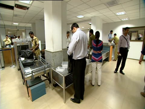 Passengers pass through security at Delhi Airport