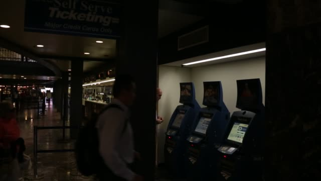 Passengers pick up tickets from the QuikTrak selfservice kiosks at Union Station Washington DC May 26 2015