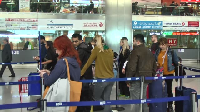 passengers place electronic devices in their luggage and show their electronic equipment at security point at the ataturk international airport in... - security equipment stock videos & royalty-free footage
