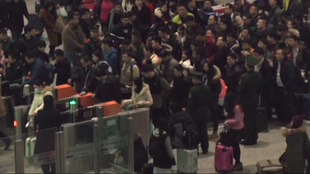passengers prepare to board trains at hongqiao railway station as they make their way home for lunar new year in shanghai china on february 04 2016... - family reunion stock videos and b-roll footage