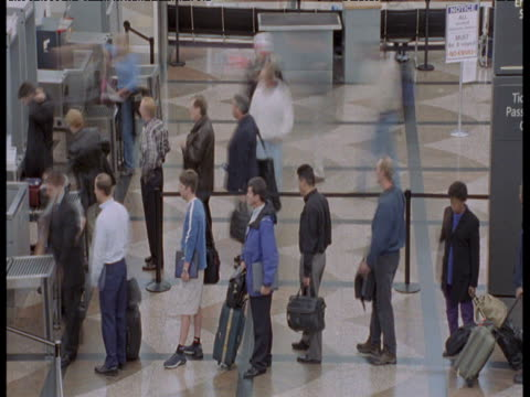 passengers queue to get through security, denver airport - in a row stock videos & royalty-free footage