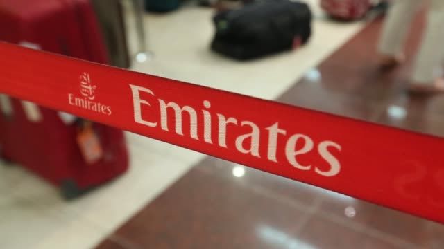 passengers queue with their luggage at the emirates check-in desks at dubai international airport in dubai, united arab emirates , on monday, nov. 10... - passenger stock videos & royalty-free footage