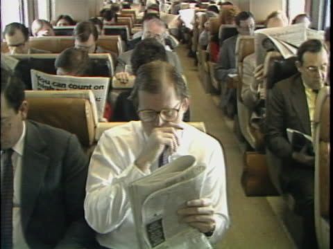 passengers reading the newspaper on a train - reading stock videos & royalty-free footage