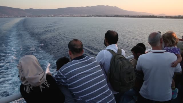 Passengers relax on board the Blue Star ferry bound for Athens from Kos on August 31 Greece Migrants from many parts of the Middle East and African...