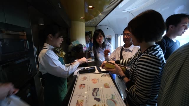 passengers relax on the yufuin no mori limited express train operated by kyushu railway co in fukuoka prefecture japan on tuesday oct 11 the kyushu... - kyushu railway stock videos & royalty-free footage