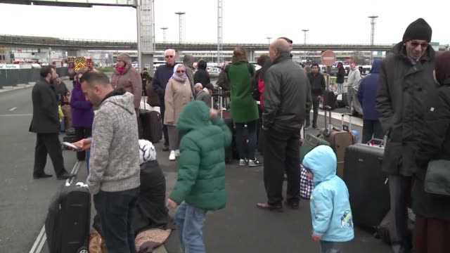 Passengers respond with patience after a major security alert shut down Paris' Orly airport