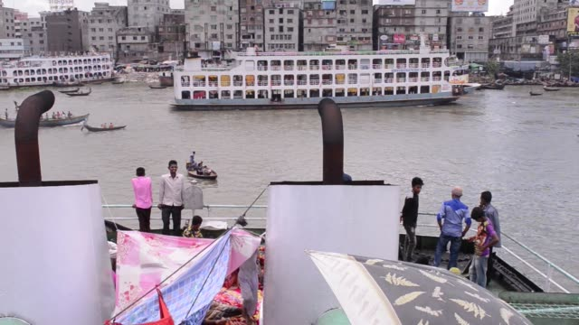 passengers ride a ferry as another is seen sailing through buriganga river ahead of eid al-fitr in dhaka, bangladesh, on saturday, june 24, 2017 - ferry ride stock videos & royalty-free footage