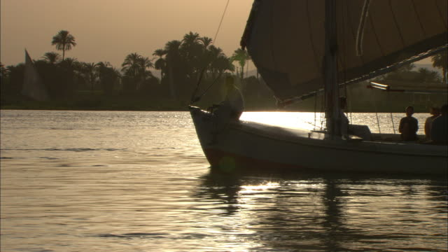 Passengers ride in a sailboat along the Nile in Egypt.