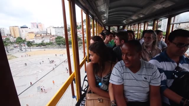 passengers ride on the first day of preoperations on the partially re opened santa teresa tram line or 'bonde' on july 27 2015 in rio de janeiro... - bonde stock videos and b-roll footage