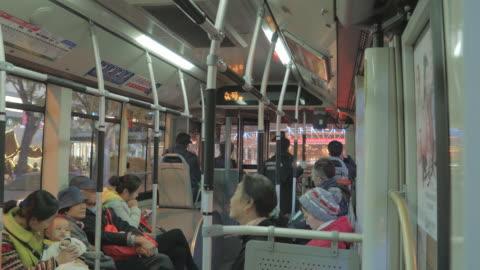 ws passengers riding bus, beijing, china - sitting stock videos & royalty-free footage