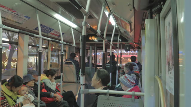 ws passengers riding bus, beijing, china - sitting stock videos & royalty-free footage
