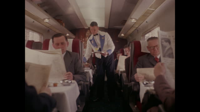 1960 - passengers served drinks by stewards on pullman train - compartment stock videos & royalty-free footage