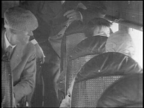 b/w 1927 passengers sitting in airliner looking out of windows / newsreel - vehicle seat stock videos & royalty-free footage