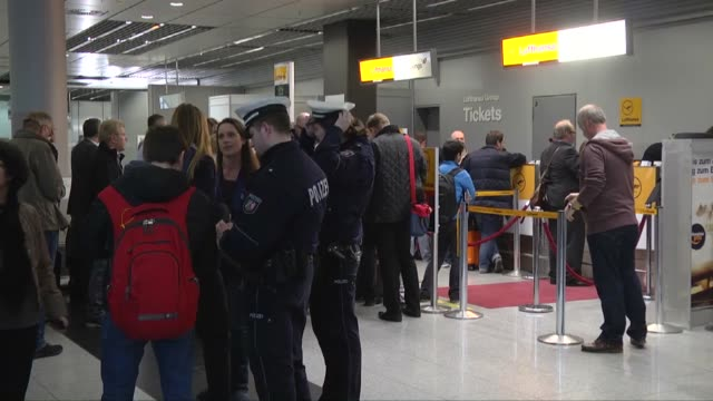 Passengers stand in front of checkin counter of the airline Germanwings at the airport in Duesseldorf Germany on 24 March 2015 after Airbus A320...