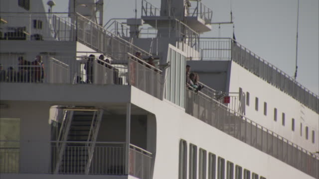 passengers stand on the deck of a ferry as it pulls out of dover harbour. - ferry deck stock videos & royalty-free footage