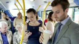 Passengers Standing On Busy Commuter Bus