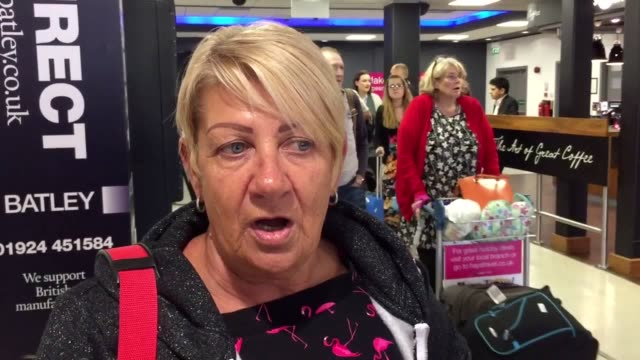 stockvideo's en b-roll-footage met passengers stranded by monarch's collapse arrive back in uk from dalaman, turkey, on repatriated flight to leeds bradford airport. interviews with... - repatriëring