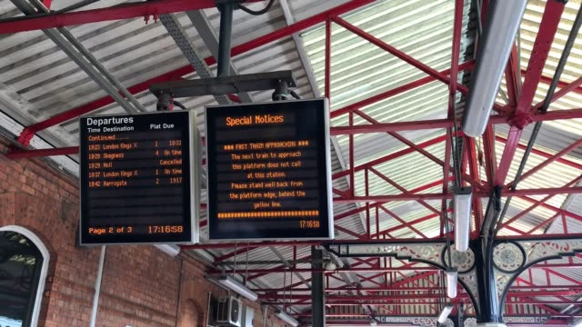 passengers suffer delays at grantham station in lincolnshire after hot weather grinds railway services to a halt. - lincolnshire stock videos & royalty-free footage