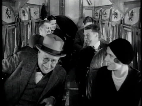 1928 montage passengers taking seats inside airplane and shadow of plane as it is taking off / united states - 1928 bildbanksvideor och videomaterial från bakom kulisserna
