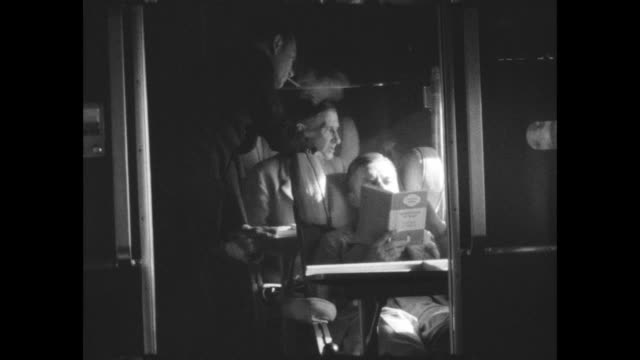 passengers talking, reading and smoking in the passenger cabin on a short empire 'c' class flying boat. - passenger stock videos & royalty-free footage