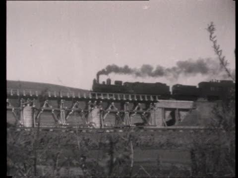 stockvideo's en b-roll-footage met passengers travelling on great turkestansiberian railway through steppe / russia - 1927