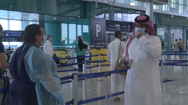passengers undergo temperature checks at the departure hall for domestic flights at king khalid international airport in riyadh following a sanitary... - saudi arabia stock videos & royalty-free footage