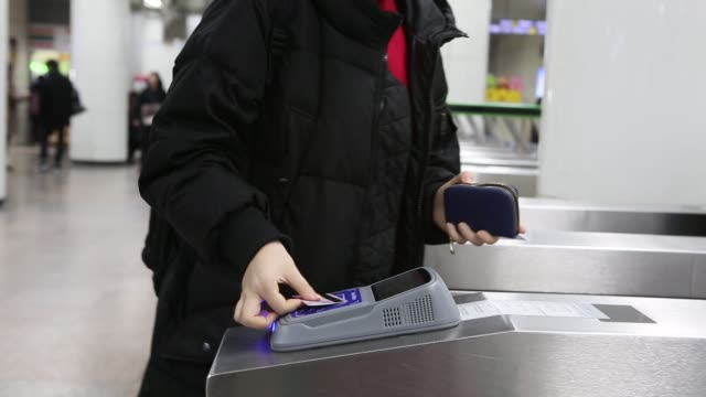 vídeos y material grabado en eventos de stock de passengers use the samsung pay transportation card service developed by samsung electronics co at a fare gate inside a subway station in seoul south... - entrada