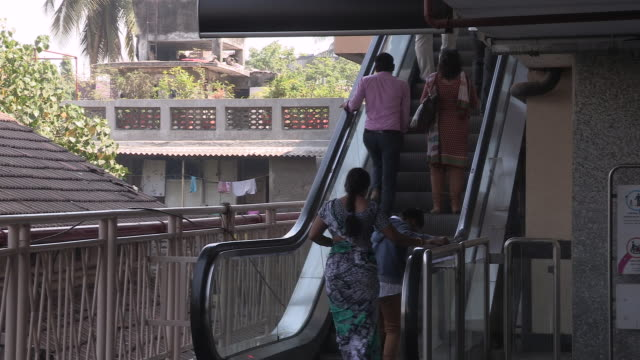 Passengers using an escalator ascend towards a monorail platform Mumbai Maharashtra India FKAD675A Clip taken from programme rushes ABQA810K