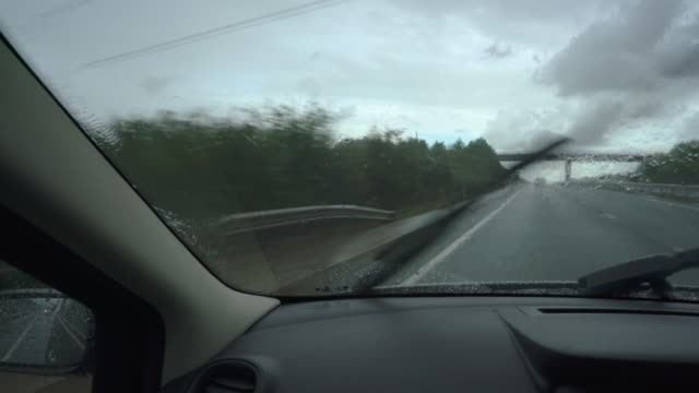 passenger's view of driving in rain - car interior stock videos & royalty-free footage