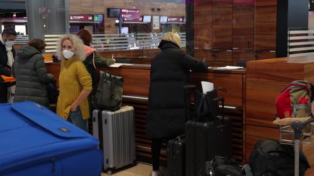 passengers wait at the check-in counter in terminal 1 at the new ber berlin brandenburg airport during the airport's first week of public operation... - airport check in counter stock videos & royalty-free footage