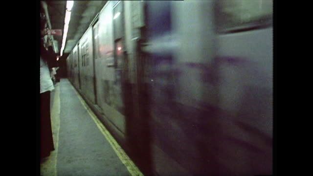 passengers wait for a subway train in new york; 1976 - bbc archive stock-videos und b-roll-filmmaterial