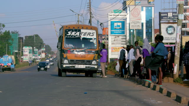 passengers wait for matatus at bus stop ngong road, nairobi, kenya, africa - bus billboard stock videos & royalty-free footage