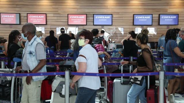 passengers wait in line to check in at orly airport on june 26, 2020 in orly, france. air traffic is still low and for the moment only terminal 3 is... - getting away from it all stock videos & royalty-free footage