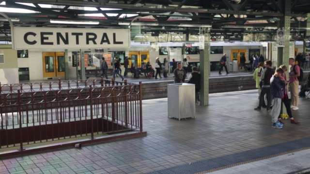 passengers wait on platform as train leaves sydney central station - train vehicle stock videos & royalty-free footage
