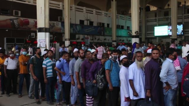 passengers wait to leave the capital amid the spread of coronavirus at kamlapur railway station in dhaka bangladesh on march 20 2020 - bangladesh stock videos & royalty-free footage