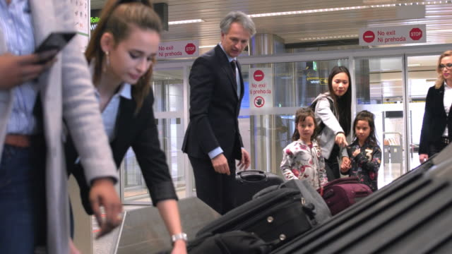passengers waiting for baggage at airport - baggage claim stock videos and b-roll footage