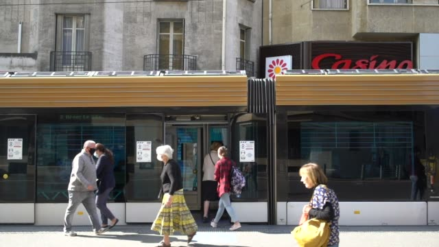 """passengers waiting for the tramway at station """"cinq avenues"""" on september 30 in marseille, france. the port city of marseille has ordered all bars... - veicolo terrestre commerciale video stock e b–roll"""