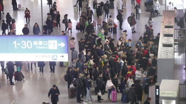 passengers waiting in line to ticket counters at hongqiao railway station shanghai china on saturday january 18 2020 - ticket counter stock videos & royalty-free footage