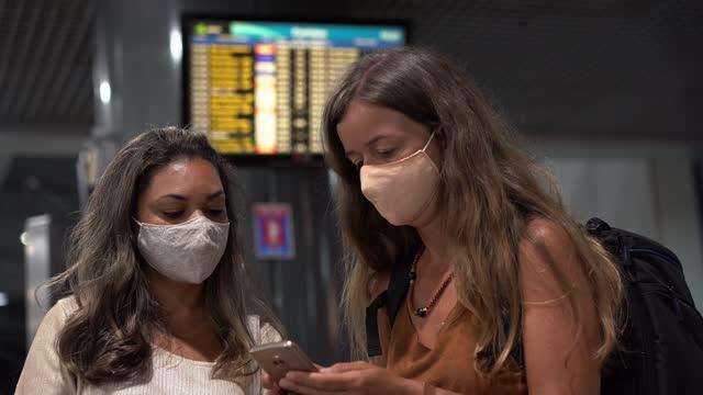passengers waiting near the flight information panel - digital signage stock videos & royalty-free footage