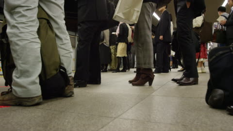 passengers waiting on the platform for a train to arrive - underground station platform stock videos & royalty-free footage