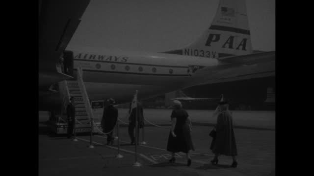 passengers walk across tarmac at idlewild airport , board pan am flight - john f kennedy airport stock videos & royalty-free footage