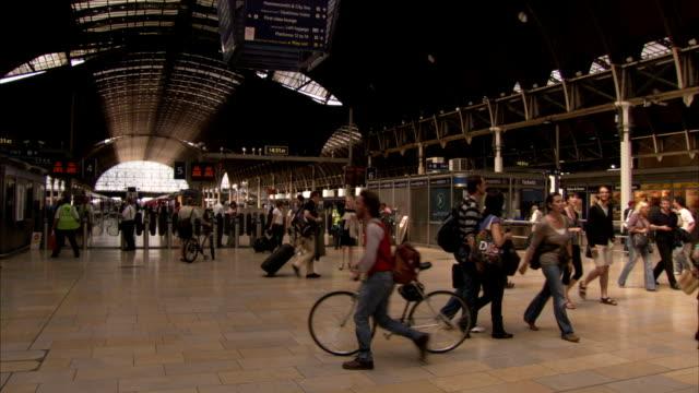 passengers walk in london paddington railway station. available in hd. - paddington railway station stock videos & royalty-free footage