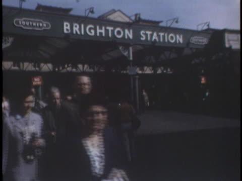 passengers walk on the platform of the train station in brighton, england. - brighton england stock videos & royalty-free footage