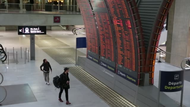 passengers walk past a flight departure information display at charles de gaulle airport operated by aeroports de paris in roissy france on tuesday... - charles de gaulle stock videos & royalty-free footage