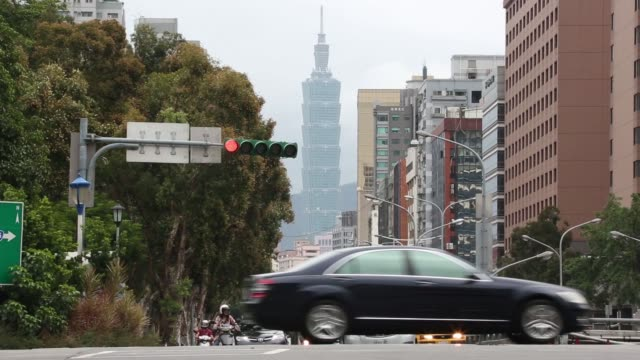 passengers walk through a train station in taipei taiwan on monday nov 9 signage for taipei is displayed above flying taiwanese flags the national... - taipei 101 stock-videos und b-roll-filmmaterial