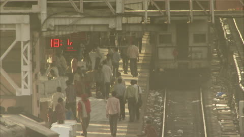 .passengers walk through jaipur railway station. available in hd - smog stock videos & royalty-free footage