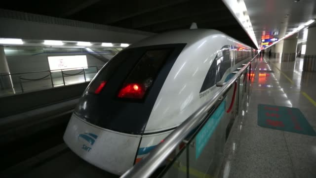 passengers walk to the platform of a magneticlevitation train operated by shanghai maglev transportation development co at the shanghai pudong... - levitation stock videos and b-roll footage
