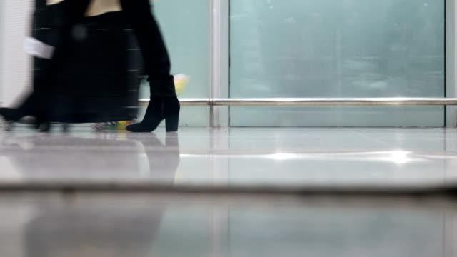 Passengers walking in corridor